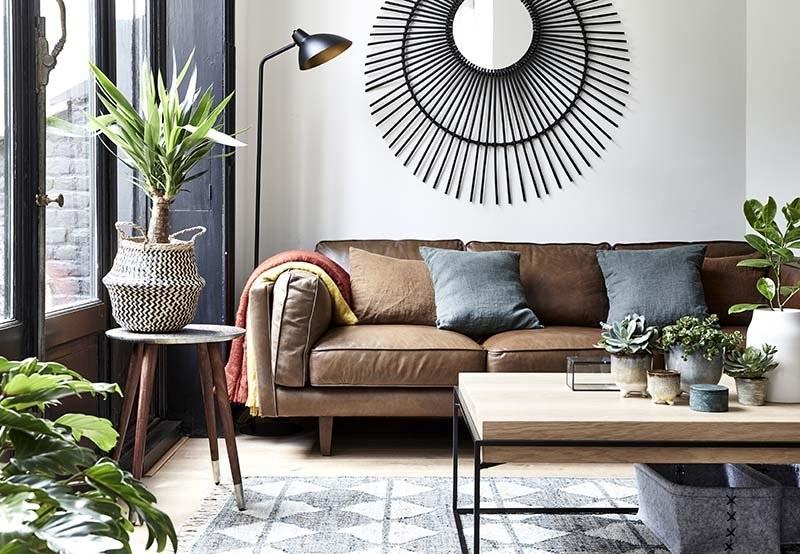 Un Canapé En Cuir Pour Un Salon Contemporain Et Chaleureux –