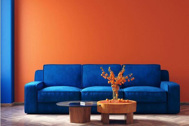 Canapé Bleu Et Mur Orange –